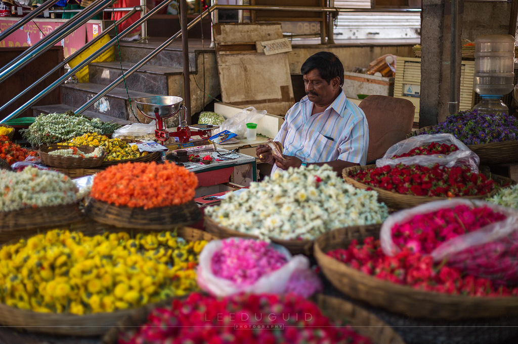 man selling flowers offerings India