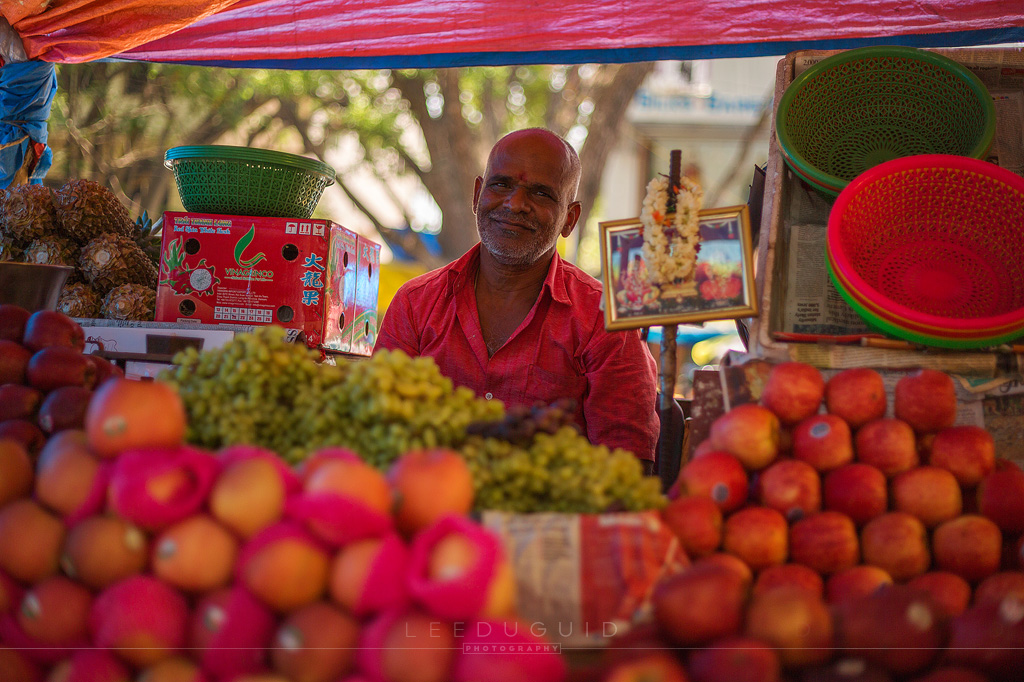 man selling fruit market India