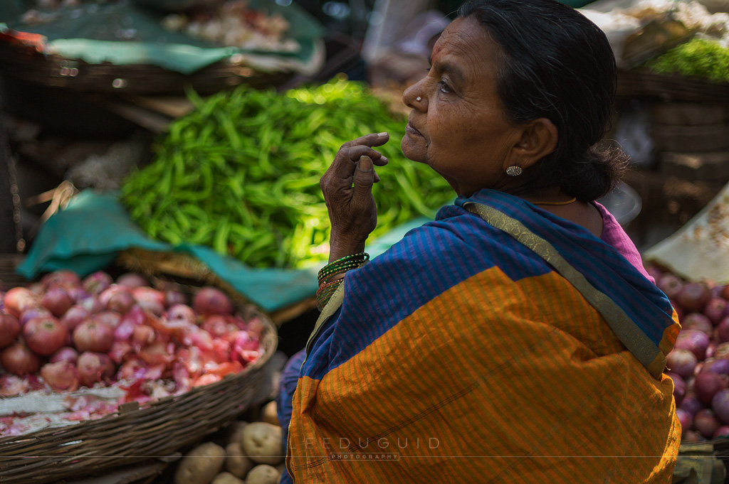 market elderly woman vegetables